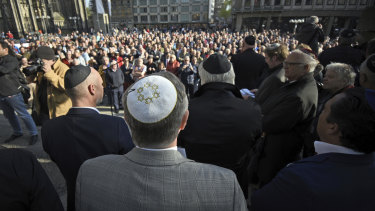Jewish protesters are seen wearing the kippa, or skullcap, in a protest against anti-Semitism in Berlin.