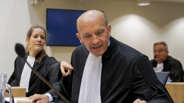Sabine ten Doesschate, left, and Boudewijn van Eijck, lawyers for one of the four suspects, Russian Oleg Pulatov, are seen at the trial at the high security court building at Schiphol Airport, near Amsterdam.