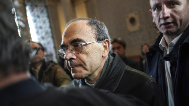 French Cardinal Philippe Barbarin, centre, arrives at the Lyon courtroom for his appeal trial on Thursday.
