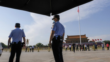 Two policemen are on duty in Tiananmen Square on Tuesday.