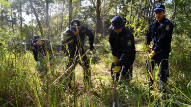 Officers near bushland in Kendall in the hunt for forensic clues into the disappearance of William Tyrrell.