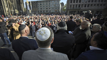 Germans of various faiths donned Jewish skullcaps and took to the streets on Wednesday in several cities to protest against an anti-Semitic attack in Berlin and express fears about growing hatred of Jews in the country.