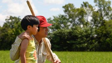 Alan Kim and Steven Yeun in Minari.