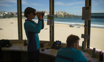 Lifeguards keep watch at Bondi Beach ahead of warmer weather this weekend.