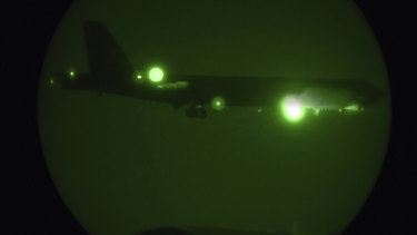 A B-52H seen through night vision coming in for a landing at Al Udeid Air Base, Qatar.