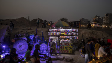A roadside mobile accessory vendor waits for customers near Delhi, India, where the government has rolled out new regulations for social media companies.