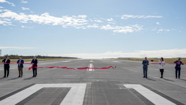 """A light-hearted moment as Queensland Governor Paul de Jersey """"jumped the gun"""" on the ribbon cutting."""