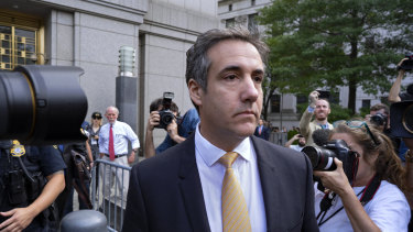 Michael Cohen, Trump's  former personal lawyer, leaves federal court after reaching a plea agreement in New York on Tuesday.