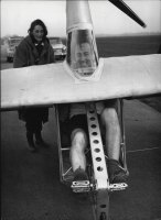 Derek Piggott, 39, puts every effort into the pedals of the flying bicycle as he prepares for a test flight of the novel machine at Lasham gliding centre, near Southampton, 1961.