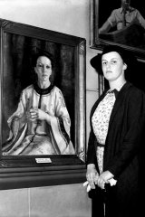 Nora Heysen with her portrait of Elink Schuurman, which won the 1938 Archibald Prize.