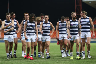 Cats players walk from the field during round one against GWS.