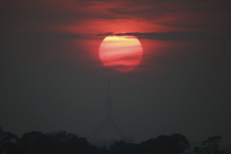 Sunrise over Parliament House, Canberra, with bushfire smoke haze in the air on December 19.