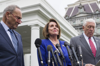 Senate minority leader Chuck Schumer, left, House Speaker Nancy Pelosi, and House majority leader Steny Hoyer.