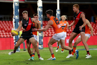 Jake Stringer is tackled during the Bombers' loss to GWS.