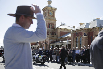 People line the street in Albury after the train arrived carrying Tim Fischer.