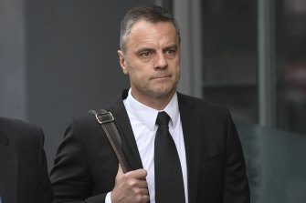 Commander Bateson outside court in 2019.