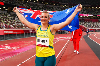 Kelsey-Lee Barber of Team Australia celebrates with the national flag after winning bronze in the women's Javelin Final.