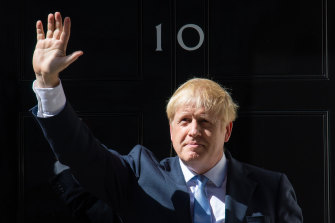 Boris Johnson waves outside 10 Downing Street earlier this year.