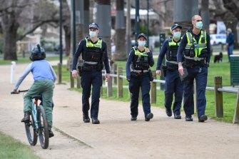 Police patrolling Princes Park last week as part of their lockdown enforcement.