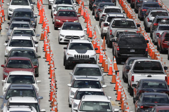 Lines of cars wait at a coronavirus testing site outside Hard Rock Stadium in Miami Gardens, Florida.