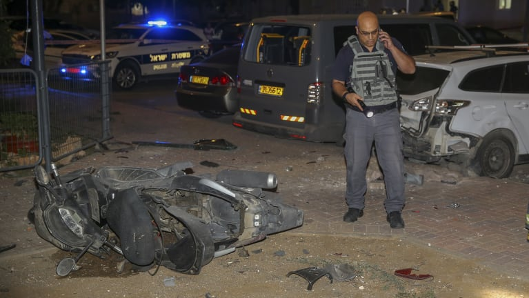 Israeli security at the site where a missile from Gaza Strip hit the town of Sderot on Wednesday.