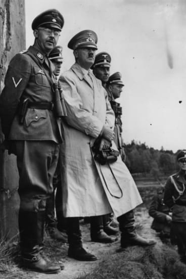 Police chief Heinrich Himmler, who was second in ranking only to Adolf Hitler himself, stands next to the German dictator.