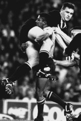 George Gregan picks up All Blacks second-rower, Mark Cooksley and dumps him during the second half of the Wallabies'Bledisloe Cup Test, August 16, 1994 at the Sydney Football Stadium.