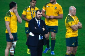 It's time: Australian coach Michael Cheika stands with captain Stephen Moore after they lost 34-17 to New Zealand in the Rugby World Cup final at Twickenham in 2015.