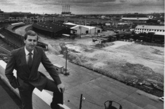 NSW minister for public works, Laurie Brereton, with Darling Harbour behind him in October 1984.