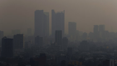 Smoke hangs over the Mexican capital on Monday.