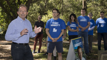 Former prime minister Tony Abbott with campaign volunteers in Manly in February.