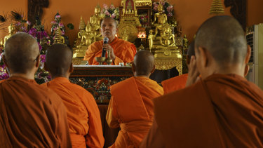 The Venerable Dhammananda, modern day Thailand's first female Theravada Buddhist monk, leads a ceremony.