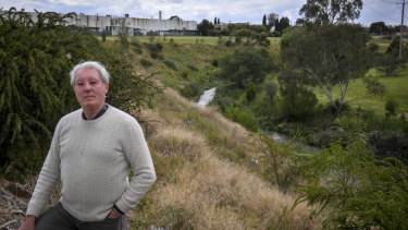 Fawkner resident Brian Snowden at the rear of the contaminated site approved for redevelopment.