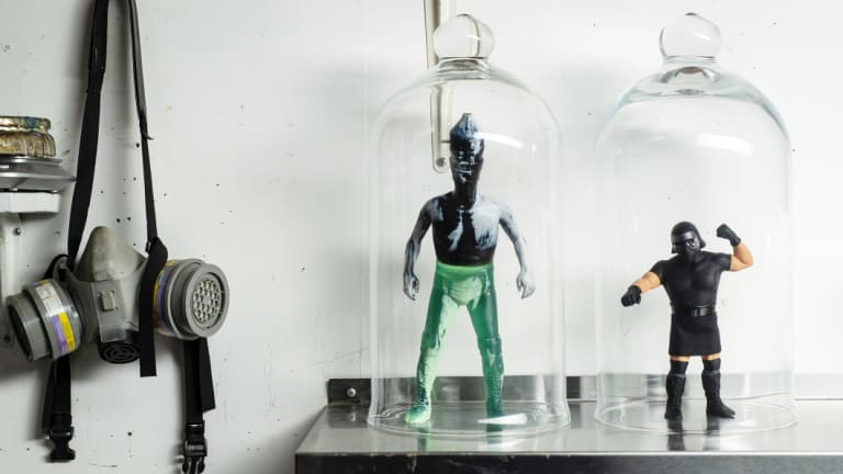 'Graffiti for wimps': Artisanal action figures made by David Healey are displayed on a shelf next to a respirator at his studio in Manhattan.