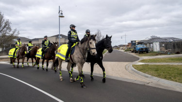 Mounted police patrol the streets of Taylors Hill on Thursday morning.