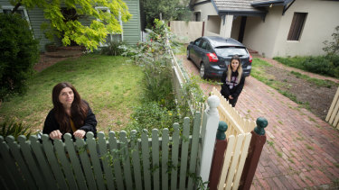 Leah Tsagaratou and her niece Millie Tsagaratos in front of their family's two homes, one of which will be acquired by the government.