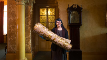 National Trust curator Elizabeth Anya-Petrivna with samples of the new Japanese wallpaper they hope to install on the walls at Rippon Lea.