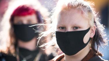Saffron Walker and Dorien Gaston   wore masks on Brunswick Street in  Fitzroy on Wednesday.