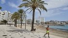A jogger on the Figueretas promenade in Ibiza, Spain.  Countries such as Italy, Mexico and Spain will be hardest hit by the fact that few people are travelling across borders this summer.
