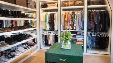 The large wardrobe is ruthlessly organised and colour-coded.