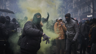 A protester throws a rock towards police during one of France's largest nationwide strikes in years.