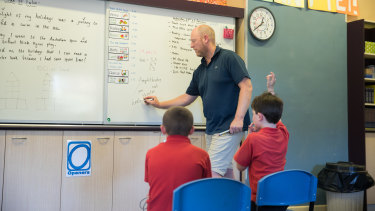 The union says teachers are 'exhausted' and working an average of 15 hours overtime per week.
