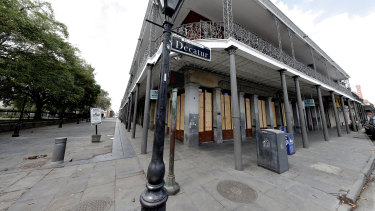 Fearing the worst: boarded up businesses are seen along Jackson Square, normally bustling with tourists, in the nearly deserted French Quarter of New Orleans.