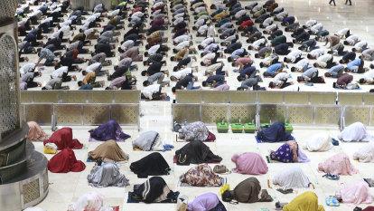 Muslims open Ramadan with socially distanced prayers, vaccines