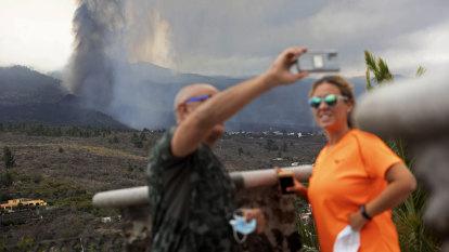 Come enjoy volcano 'show', minister urges tourists as lava destroys homes