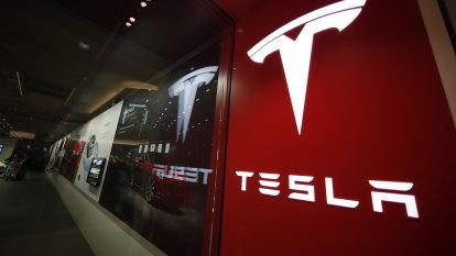 Tesla shows progress on profit as investors seek perfection