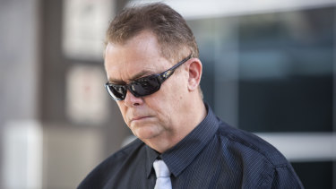 Queensland Police Senior Constable Neil Punchard leaves the Magistrates Court in Brisbane on Monday.