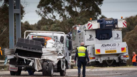 'Horrific smash': Man dies after being hit by crane on freeway