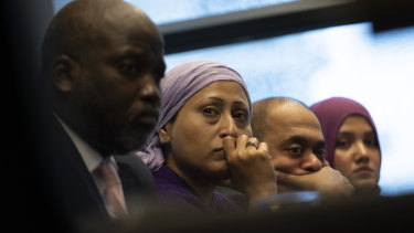 Representatives of the Rohingya community and Gambia's Justice Minister Aboubacarr Tambadou, left, listen to a testimony during a press conference in The Hague.