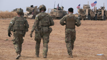 An American military convoy stops near the town of Tel Tamr, north Syria on Sunday.